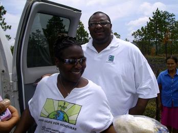 Toni & Pastor pass out food